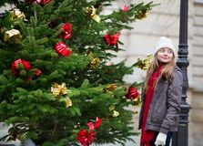 Girl with a decorated Christmas tree Royalty Free Stock Photo