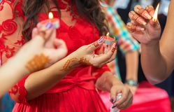 The bride decorated with a decorative candlestick in her hands and a sign . holds a candle in her hand . in the background without Royalty Free Stock Images
