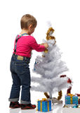 Girl decorates a Christmas tree Royalty Free Stock Image