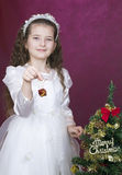 Girl decorates  christmas tree Royalty Free Stock Photography