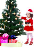 Girl decorates the Christmas tree Stock Image