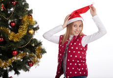 Girl decorates the Christmas tree Stock Photo