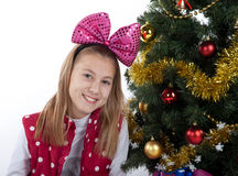 Girl decorates the Christmas tree Royalty Free Stock Photography