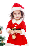 Girl decorates the Christmas tree Royalty Free Stock Photo