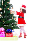 Girl decorates the Christmas tree Royalty Free Stock Photos