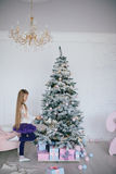 Girl decorates the Christmas tree Stock Photo