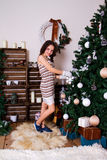 Girl decorates a Christmas tree Royalty Free Stock Photography