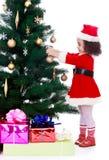 Girl decorates the Christmas tree Royalty Free Stock Image