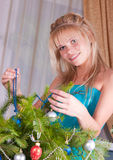 The girl decorates fur-tree branches Stock Image
