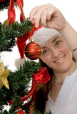 Girl decorating a christmas tree Stock Image