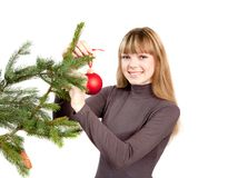The girl decorating the christmas tree Royalty Free Stock Photos