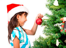Girl decorating the Christmas tree Royalty Free Stock Photos