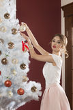 Girl decorating christmas tree Royalty Free Stock Photo