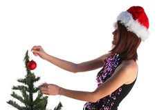 Girl decorating christmas tree Stock Photography