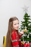 Girl decorating the christmas tree Royalty Free Stock Image