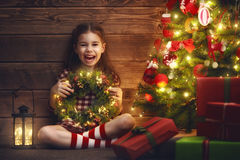 Girl is decorating the Christmas tree Royalty Free Stock Photos