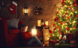 Girl is decorating the Christmas tree Stock Photos