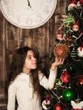 Girl decorating the christmas tree Royalty Free Stock Image