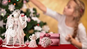 Girl decorating christmas tree stock footage