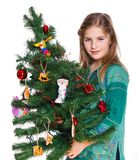 Girl decorating christmas tree. Stock Photography