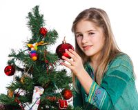 Girl decorating christmas tree. Royalty Free Stock Photos