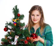 Girl decorating christmas tree. Royalty Free Stock Photography