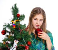 Girl decorating christmas tree. Royalty Free Stock Photo