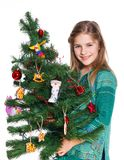 Girl decorating christmas tree. Stock Photos