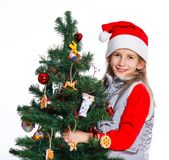 Girl decorating christmas tree. Stock Images