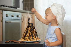 Girl decorating a hot chocolate volcanoe cake.  Royalty Free Stock Image