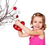 Girl decorating valentine tree Royalty Free Stock Photography
