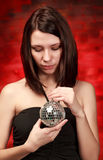 Girl with decoration ball Stock Photography