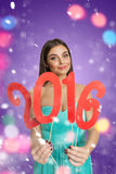 Girl with decorative plate of New Year Stock Photography