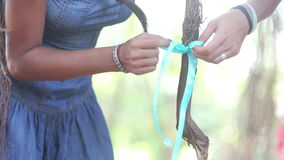 Girl decorator tying ribbons on the branches stock video footage