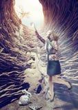 Girl in the deep hole. Girl flies out of a deep hole toward the sunlight. creative concept Royalty Free Stock Photos
