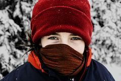 Girl in deep winter with disguised face Stock Photos