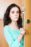 Girl with defective door lock Royalty Free Stock Photo
