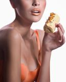 Girl with delicious orange praline Royalty Free Stock Photo