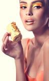 Girl with delicious orange praline Stock Image