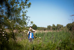 Girl in delta landscape Stock Photography