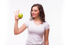 Girl demonstrate ok sigh with apple. In hand Royalty Free Stock Images