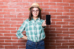 Girl demonstrate on smartphone Royalty Free Stock Images