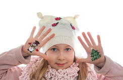 Girl demonstrating Christmas symbols painted on her hands. Snowman and Christmas tree Stock Images