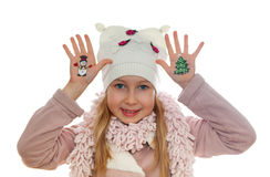 Girl demonstrating Christmas symbols painted on her hands. Snowman and Christmas tree Stock Photography