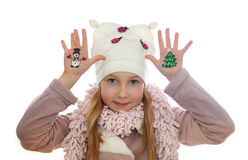 Girl demonstrating Christmas symbols painted on her hands. Snowman and Christmas tree Stock Image