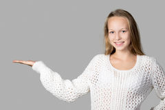 Girl demonstrating something on copyspace Royalty Free Stock Photo