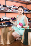Girl is demonstrating sport shoes that she choice for jogging. Royalty Free Stock Image