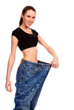 Girl demonstrating weight loss Royalty Free Stock Photo