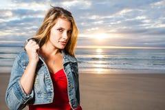 Girl in denim on the beach stock photos