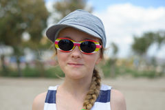 Girl in denim hat and sunglasses Royalty Free Stock Photo